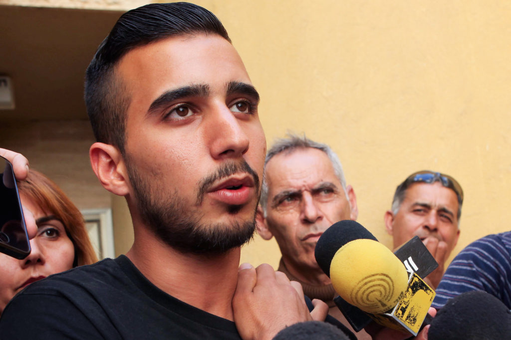 Niv Asraf speaks at a press conference outside his family home in Beersheva,April 6, 2015, a few days after he was found in Kiryat Arba after being falsely reported as missing. (Flash90)