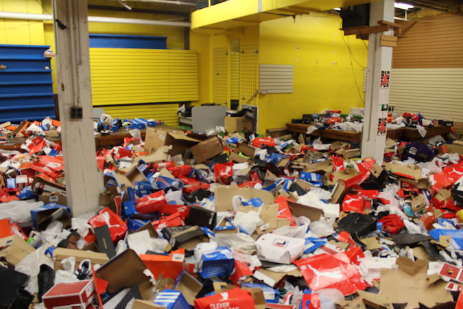 A day and a half after it was hit by looters, the inside of Baltimore store SportSmart was a sea of shoe boxes and other debris, April 29, 2015. (Hillel Kuttler)