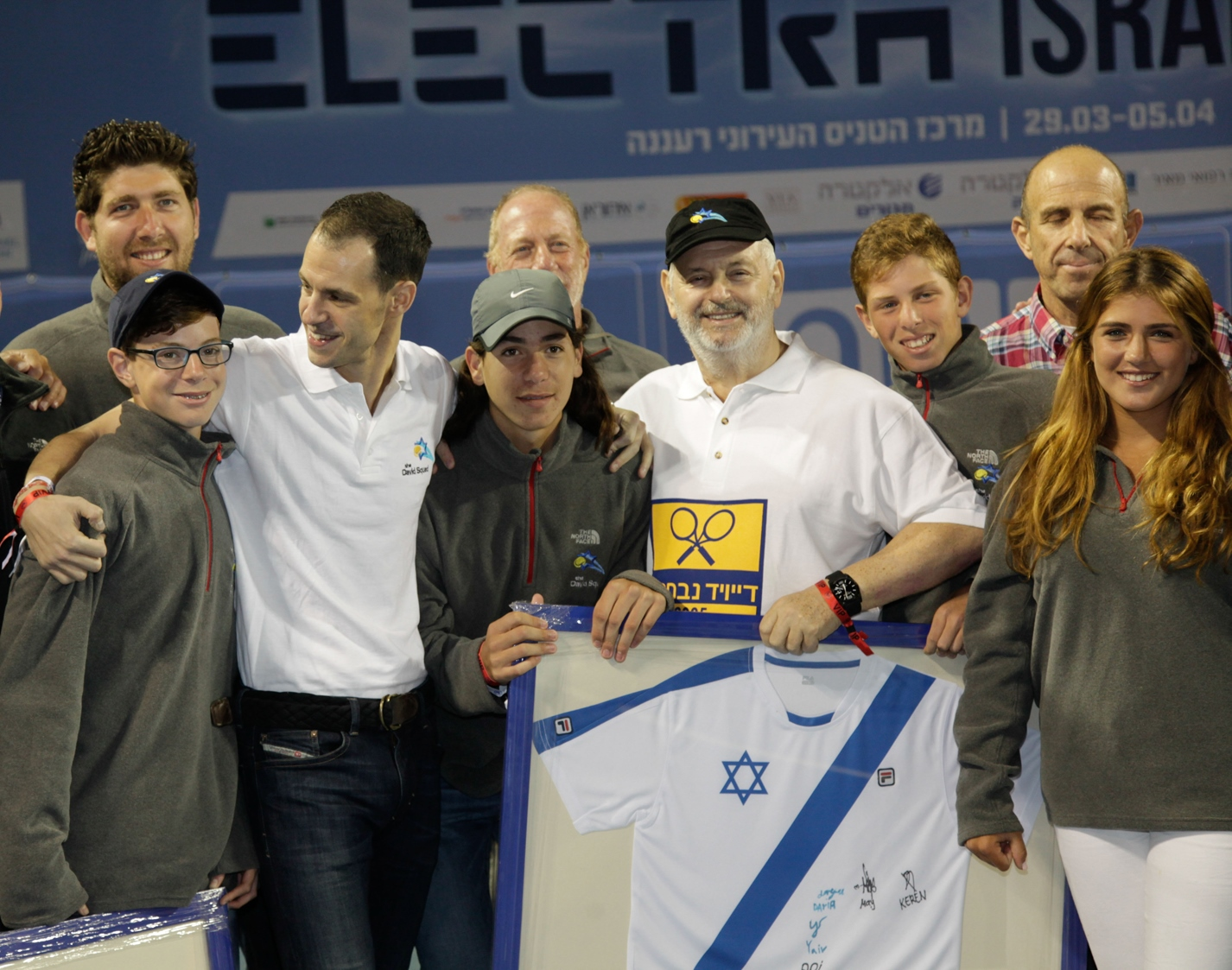 David Coffer, in black hat, at ceremony in Raanana honoring him and son Adam, third from left, for 10 years of service to Israeli tennis. (Courtesy of the David Squad)