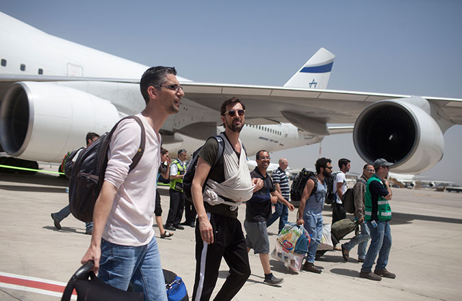 Israeli travelers with their newborn babies from surrogate mothers in Nepal disembark from an Israeli rescue plane after it landed at Ben Gurion Airport on April 28, 2015 in Tel Aviv, Israel. (Lior Mizrahi/Getty Images)