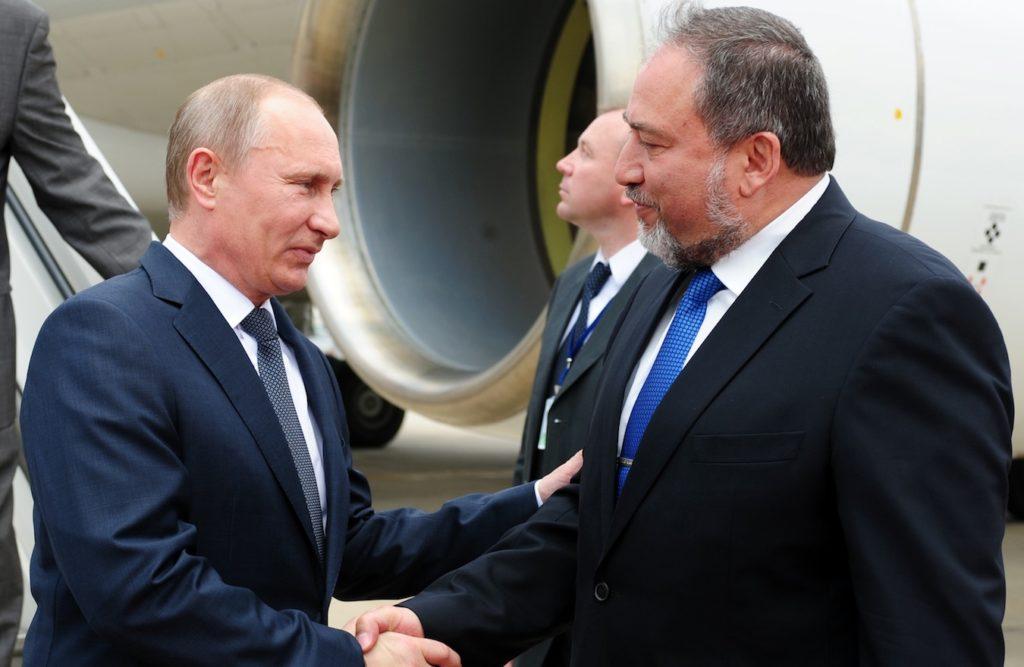 Israeli Foreign Minister Avigdor Liberman, right, receiving Russian President Vladimir Putin at Ben Gurion Airport, June 25, 2012. (GPO/Kobi Gideon)