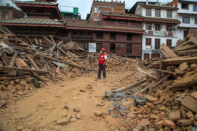 An earthquake emergency team members walks through debris from one of the UNESCO World Heritage site temples in Basantapur Durbar Square on April 28 in Kathmandu, Nepal.  (Omar Havana/Getty Images)