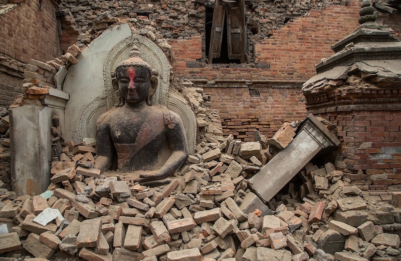 A statue of the Buddha surrounded by debris from a collapsed temple in Bhaktapur, Nepal, April 26, 2015. (Omar Havana/Getty Images)