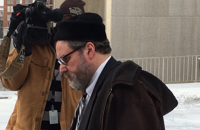 Rabbi Barry Freundel exiting the courthouse after entering his guilty plea, Feb. 19, 2015.