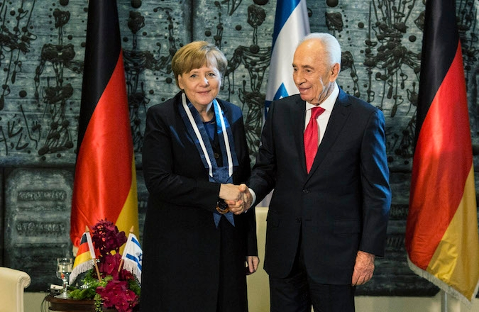 German Chancellor Angela Merkel received Israeli President Shimon Peres (R) during a ceremony at Israeli Presidents resedency on February 25, 2014 in Jerusalem, Israel. (Ilia Yefimovich/Getty Images)