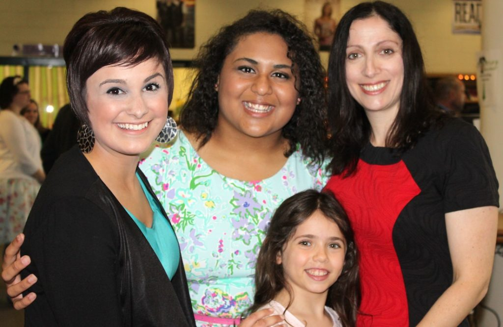 Students Maria Morava, left, and Breeana Clayton, second from left, with Suzanne Goldberg and her daughter Shira. (Molly McGowan Gorsuch)