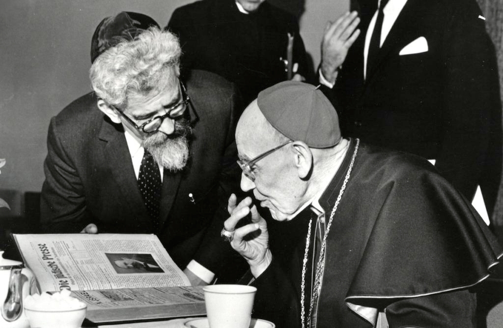 Rabbi Abraham Joshua Heschel meeting in New York with Cardinal Augustine Bea, who shepherded the process of Catholic introspection that led to Nostra Aetate, March 31, 1963. (American Jewish Committee)