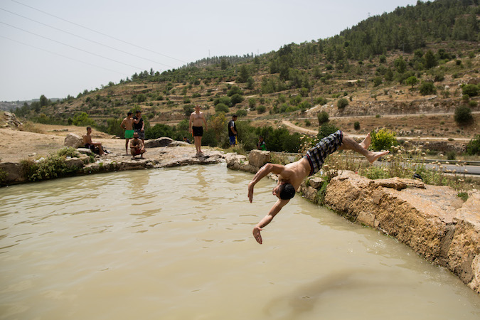 israel heat wave swimming