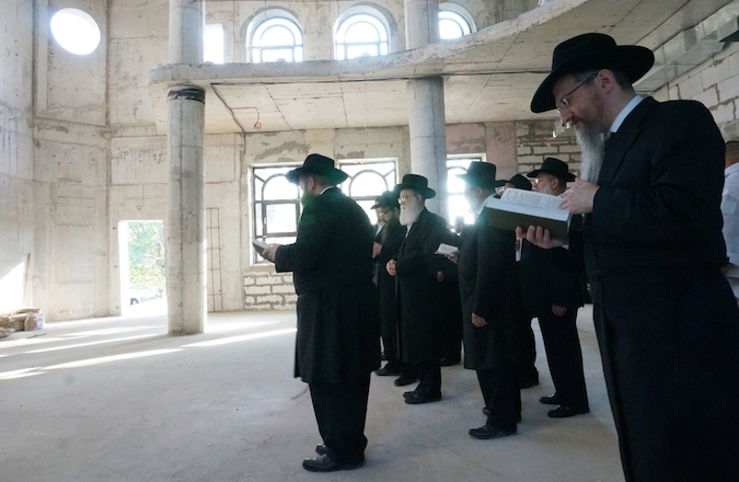 Berel Lazar, right, with Chabad rabbis at an unfinished synagogue in Sevatopol, Crimea, on July 14, 2014. (Cnaan Liphshiz)