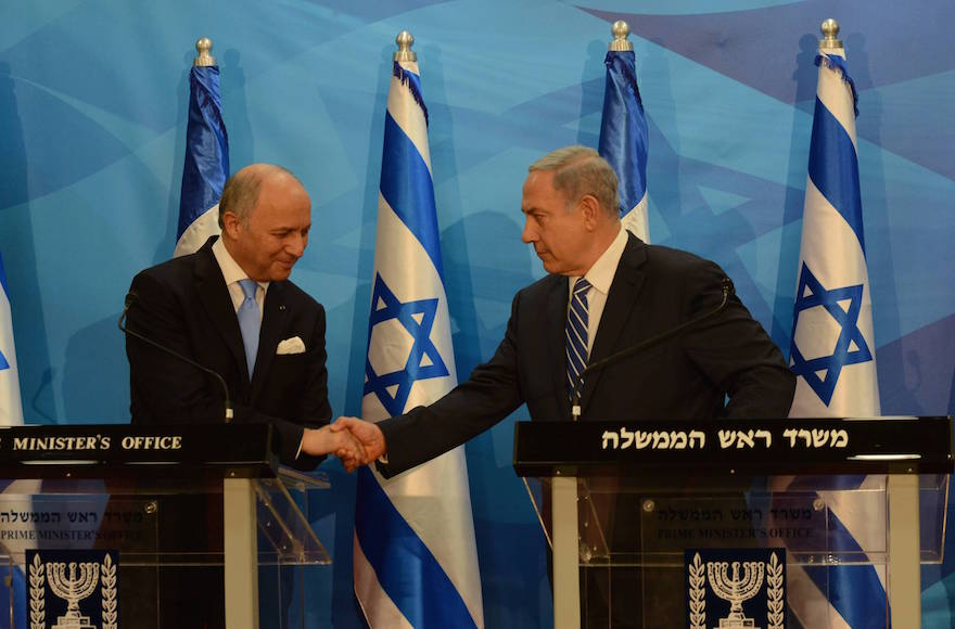 Israeli Prime Minister Benjamin Netanyahu meets with French Foreign Minister Laurent Fabius in Israel on June 21, 2015. (Haim Zach/GPO)