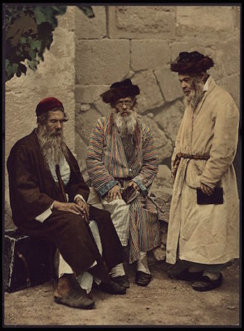 Spiritual Jews from the first Aliyah (migration wave) in Jerusalem gather for prayer. Jews fled Eastern Europe after the assassination of Czar Alexander II and the rise of pogroms in 1881. Most went to America, but 2-3% went to Palestine. (Courtesy of Israel National Library)