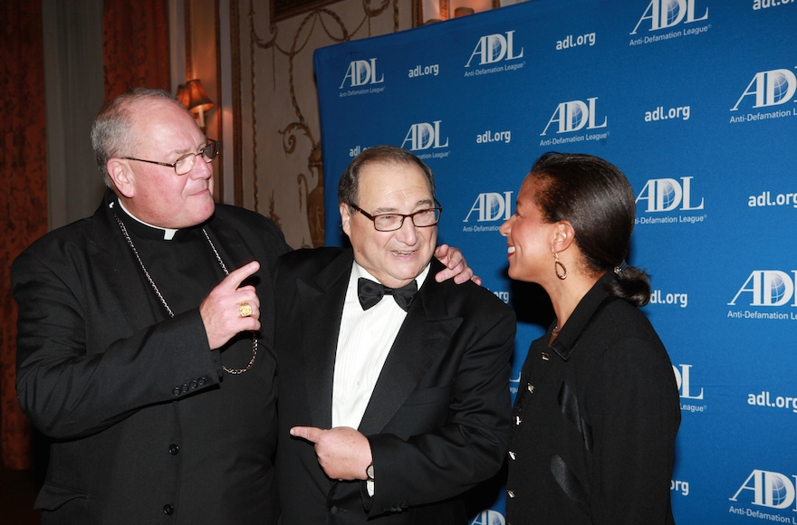 Abe Foxman (center) talks with Cardinal Timothy Dolan (left) and U.S. National Security Advisor Susan Rice (right) at an event honoring him in New York on June 17, 2015. (David Karp)