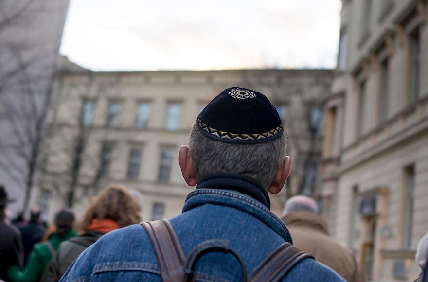A man wears a kippah as he takes part in a silent march to commemorate the 75th anniversary of the Kristallnacht pogroms on November 9, 2013 in Berlin, Germany. (Carsten Koall/Getty Images)
