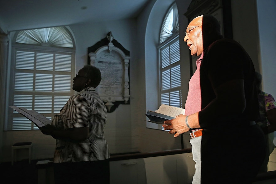Mourners sing hymns during a community prayer service for the nine victims of the shooting at the historic Emanuel African Methodist Episcopal Church, at Second Presbyterian Church June 18, 2015 in Charleston, South Carolina. (Chip Somodevilla/Getty Images)