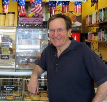 Author and educator Ron Wolfson — in a bagel shop decked out for the holiday — says the Fourth of July is a time to remember. (Edmon J. Rodmon)