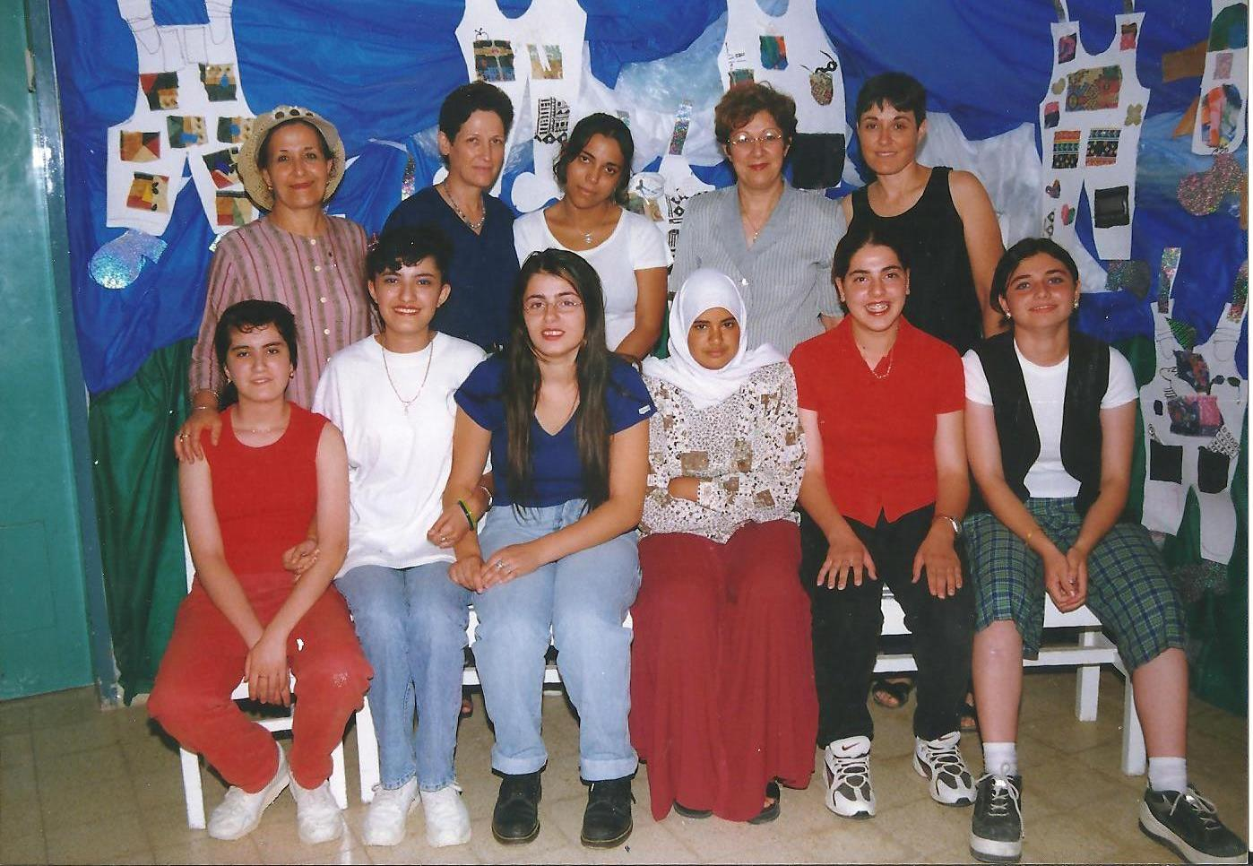 Zvia Mordechai, standing, left, and Marlene Alvez, standing, center, with fellow teachers and students in the 1990s at Beersheba's Niv School for the Deaf. (Courtesy of Zvia Mordechai)