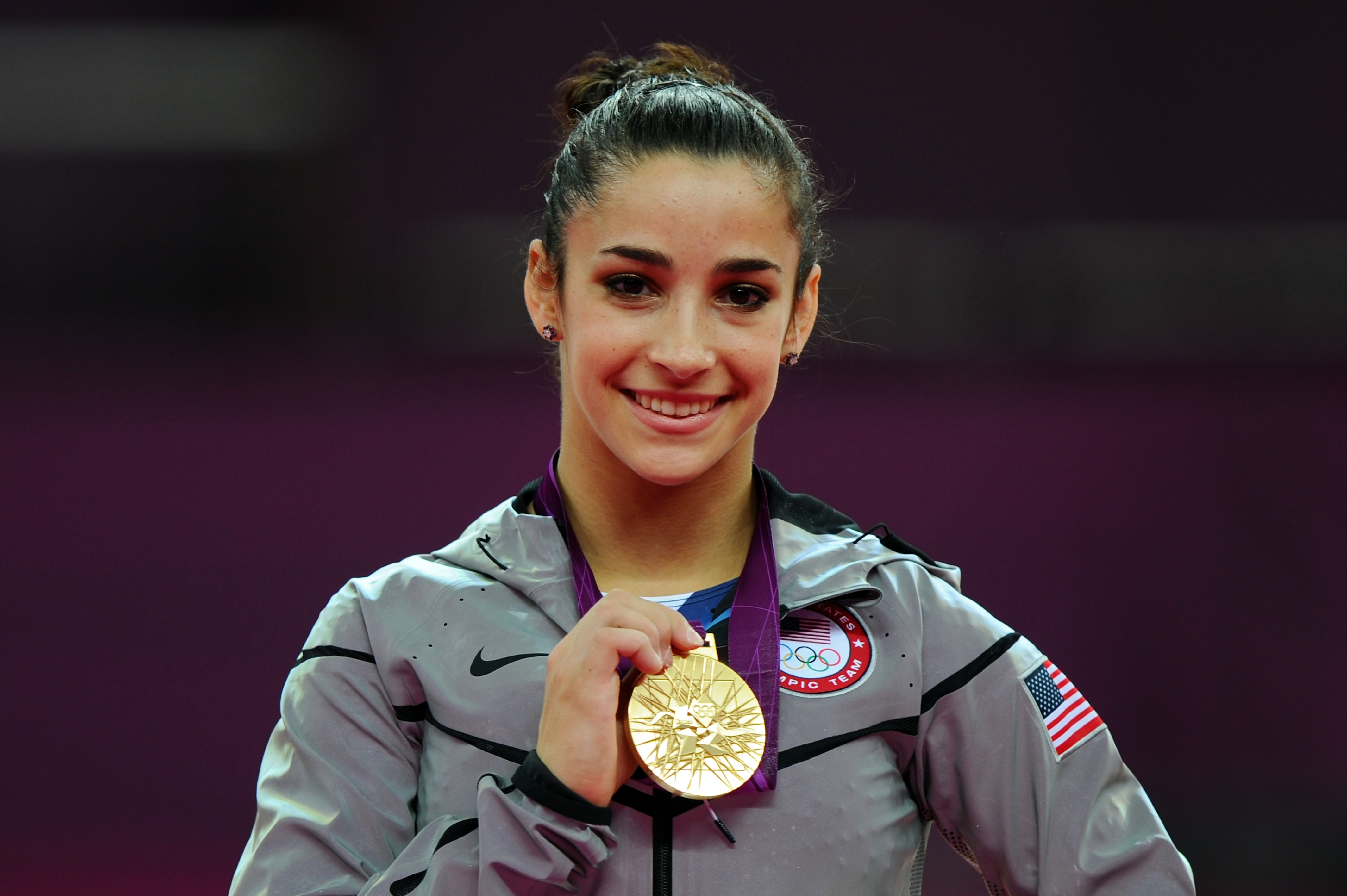Alexandra Raisman poses on the podium with her gold medal in the Summer Olympics in London, England, August 7, 2012. (Michael Regan/Getty Images)