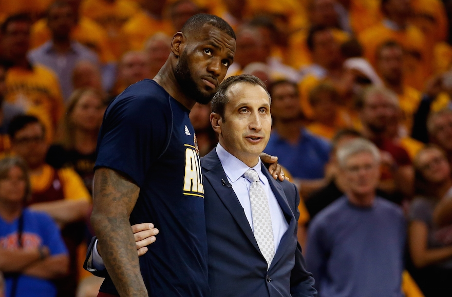 LeBron James and his Israeli-American coach David Blatt speaking late in the fourth quarter of a game against the Atlanta Hawks during the NBA's Eastern Conference Finals, May 26, 2015. (Gregory Shamus/Getty Images)
