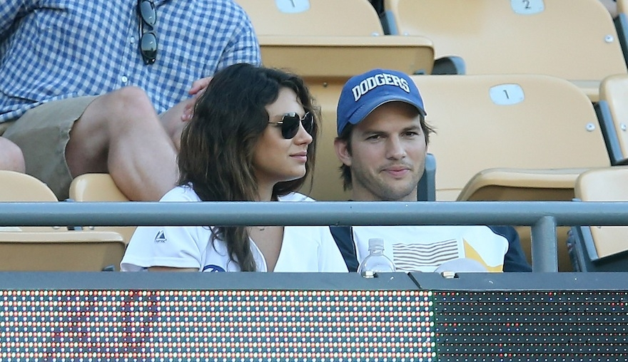 Actors Mila Kunis and Ashton Kutcher at Dodger Stadium on June 28, 2014 in Los Angeles, California. (Stephen Dunn/Getty Images)