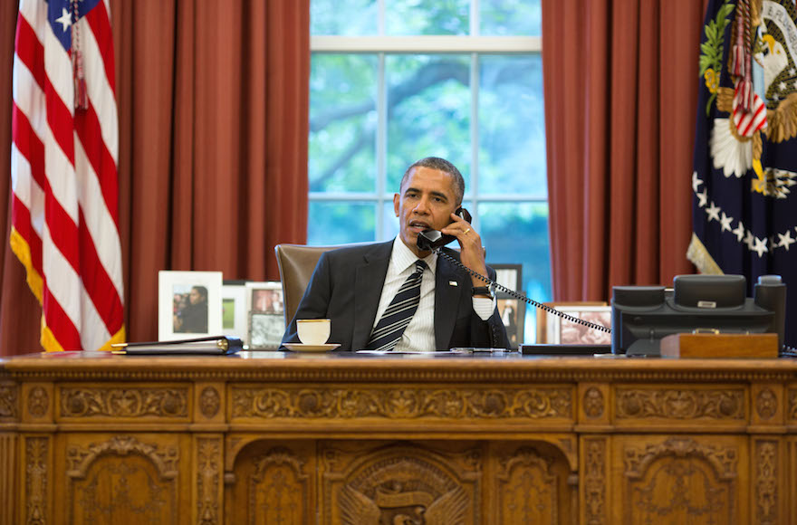 President Barack Obama talks with President Hassan Rouhani of Iran during a phone call in the Oval Office, Sept. 27, 2013. (Pete Souza/Getty Images)