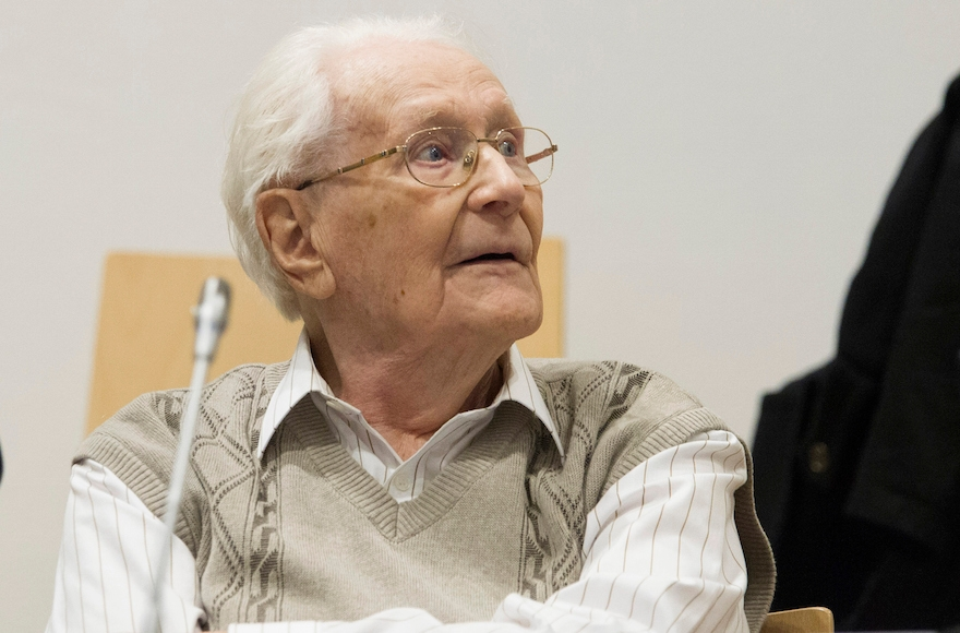 Oskar Groening, 93, arrives for the first day of his trial to face charges of being accomplice to the murder of 300,000 people at the Auschwitz concentration camp, April 21, 2015, in Lueneburg, Germany. (Andreas Tamme/Getty Images)