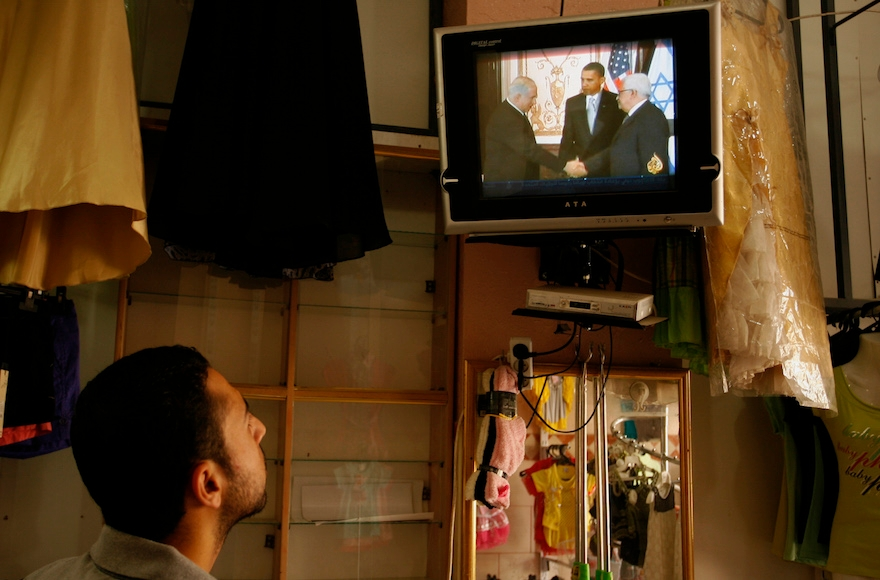 A Palestinian man watching TV in the Gaza Strip, Nov. 7, 2012. (Abed Rahim Khatib/Flash 90)