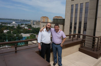 Director of the Jewish Community of Dneproptrovsk, Zelig Brez, left, and local donor Natan Zolotarevsky on the roof of the Menorah Center on July 15, 2014. (Cnaan Liphshiz)