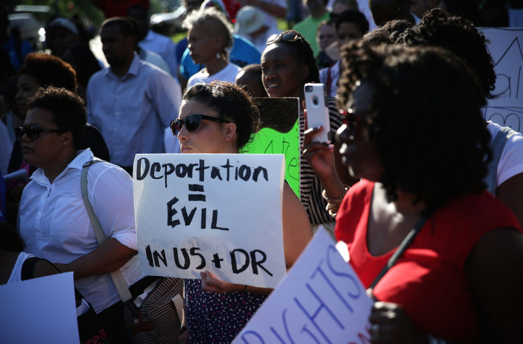Activists demonstrating in Washington, D.C. on behalf of the estimated 20,000 Dominicans of Haitian descent who were stripped of their citizenship and are facing expulsion, June 22, 2015. (Alex Wong/Getty Images)