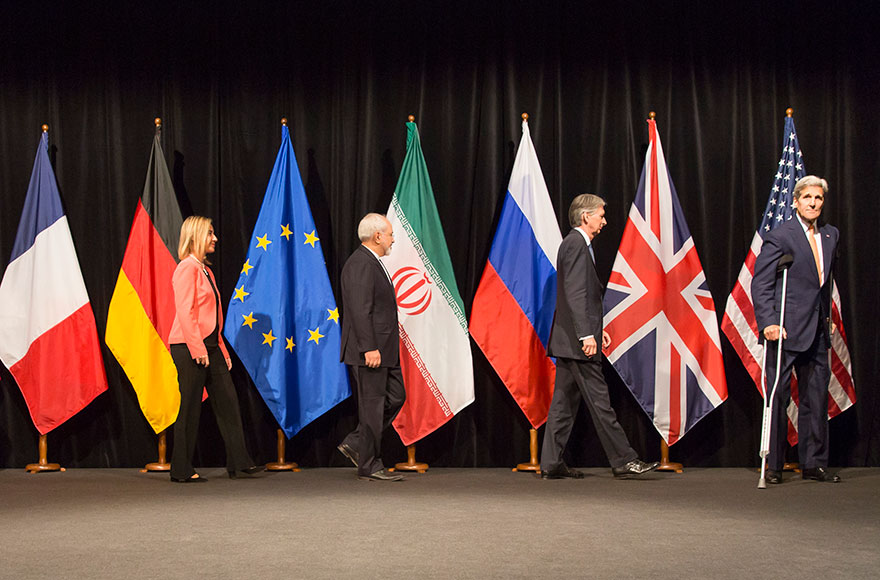 EU High Representative for Foreign Affairs and Security Policy Federica Mogherini, Foreign Minister of Iran, Mohammad Javad Zarif, British Foreign Secretary of State for Foreign and Commonwealth Affairs, Philip Hammond, and US Secretary of State John Kerry pose for a photo after last Working Session of E 3+3 negotiations on July 14, 2015 in Vienna, Austria. Six world powers; US, UK, France, China, Russia and Germany have reached a deal with Iran on limiting Iranian nuclear activity. (Thomas Imo/Photothek/Getty Images)