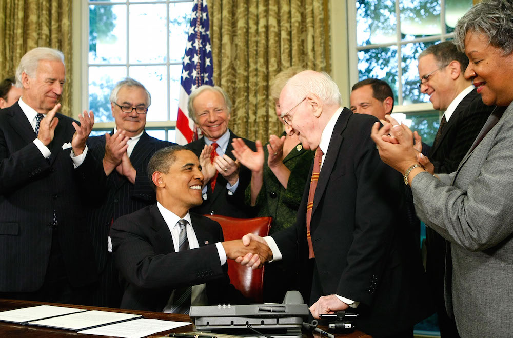 Jewish gay rights activist Frank Kameny shaking hands with President Obama after the president signed a memorandum extending federal benefits to same-sex partners of federal employees. (Photo by Alex Wong/Getty Images)