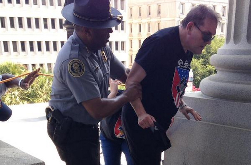 Leroy Smith, left, helped a neo-Nazi protestor survive the South Carolina heat on July 18, 2015. (Twitter)