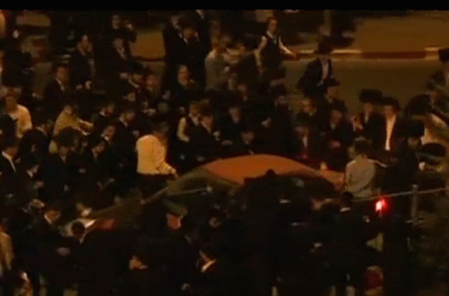 Haredi Orthodox men clashing with police at a protest against the opening of a multiplex cinema on Shabbat, in Jerusalem, on August 14, 2015. (Screenshot: Channel 10)
