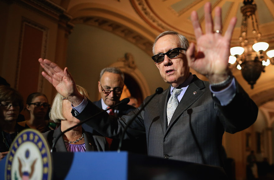 Harry Reid, D-Nev., talking with reporters with Sen. Charles Schumer, D-N.Y., at the U.S. Capitol, August 4, 2015, in Washington, D.C. (Chip Somodevilla/Getty Images)