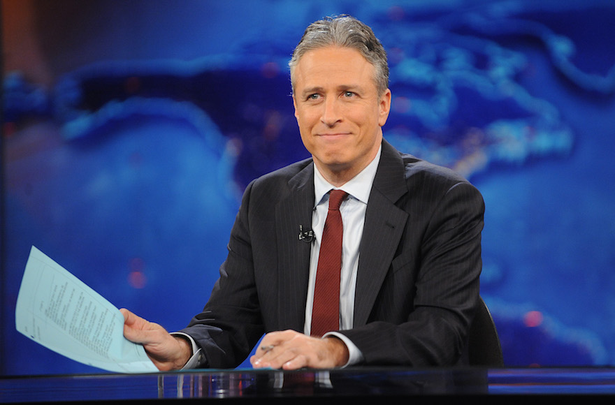 "This Nov. 30, 2011 file photo shows television host Jon Stewart during a taping of ""The Daily Show with Jon Stewart"" in New York. (Brad Barket/AP Photo)"