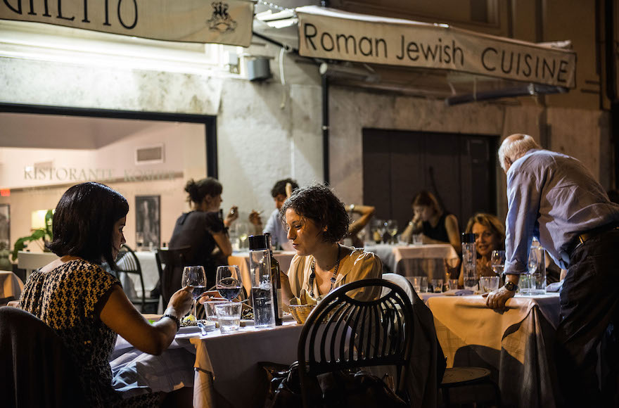People eating in a Jewish restaurant in the Ghetto district during the opening of the International Festival of Jewish Culture and Literature on July 20, 2013, in Rome, Italy. The International Festival of Jewish Culture will take place July 20 to 25. (Giorgio Cosulich/Getty Images)