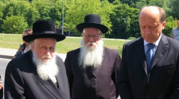 Rabbi Shaye Schlesinger (left), chairman of the Committee for the Preservation the Jewish Cemeteries in Europe, with former Lithuanian prime minister Andrius Kubilius (right) at a ceremony in Vilnius in June 2011. (Courtesy of the Committee for the Preservation the Jewish Cemeteries in Europe.)
