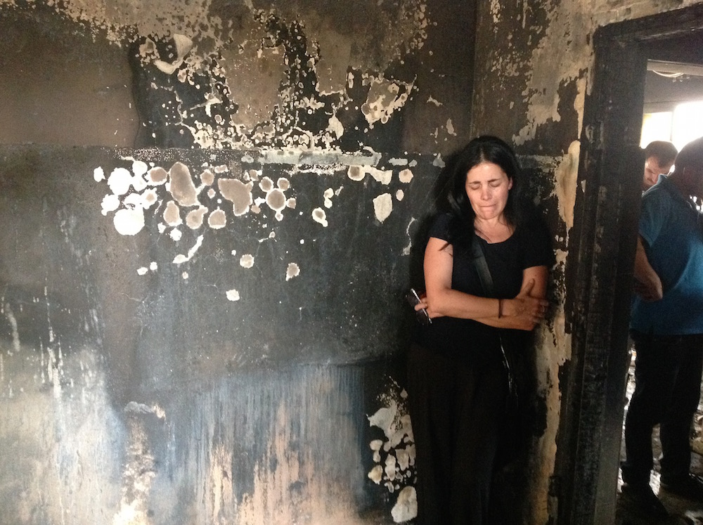 Tali Mizrahi, a member of the anti-racism group Light Tag, visiting the home of a Palestinian baby allegedly killed by Jewish arsonists. (Ben Sales)