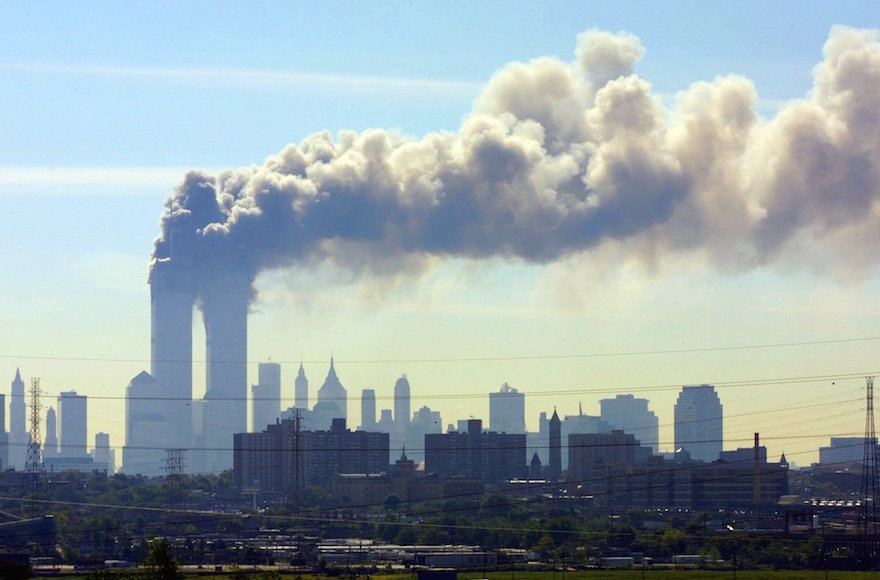 Smoke billowing from the twin towers in New York City on September 11, 2001. (Gene Boyars/AP Images)