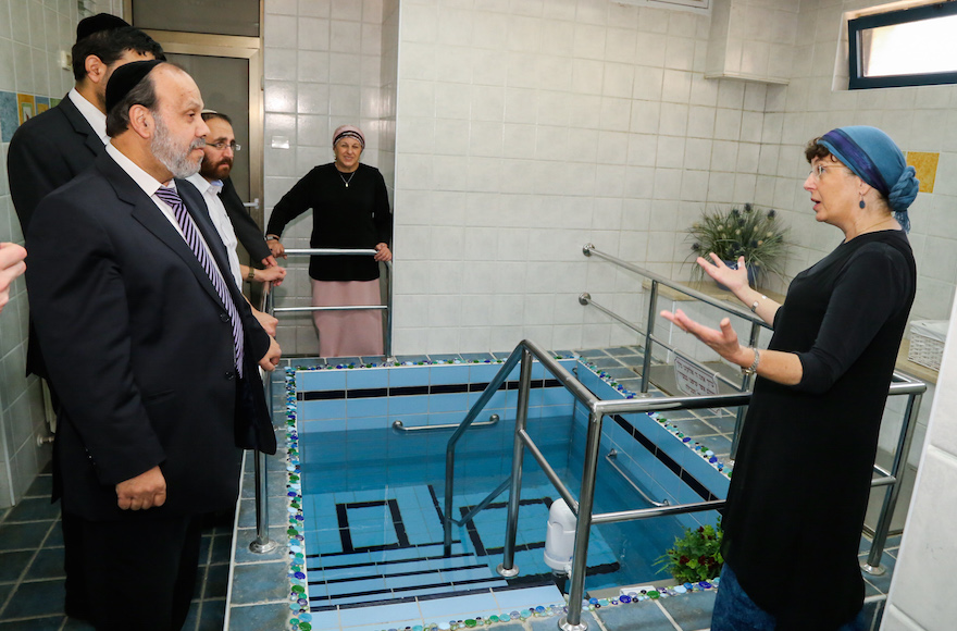 Israeli Minister of Religious Affairs David Azulay visits a luxury mikvah in the Israeli settlement of Alon Shvut, as he tours the Gush Etzion bloc on August 25, 2015. (Gershon Elinson/Flash90)