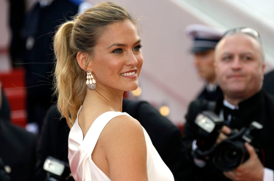 Bar Refaeli arriving for the opening ceremony of the 68th international film festival, Cannes, southern France, May 13, 2015. (Joel Ryan/Invision via AP Images)