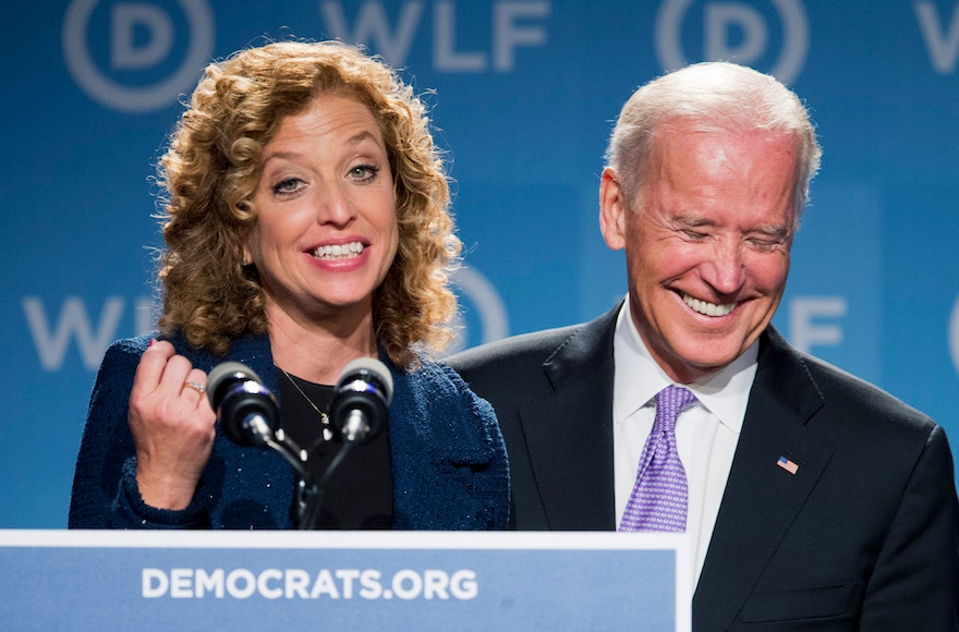 Vice President Joe Biden, right, laughing as he is introduced by DNC Chair Rep. Debbie Wasserman Schultz, D-Fla., at the DNC Women's Leadership conference in Washington, Sept. 19, 2014. (Manuel Balce Ceneta/AP Images)