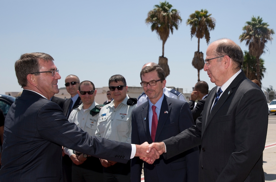 U.S. Defense Secretary Ash Carter, left, shaking hands with Israeli Defense Minister Moshe Yaalon on the tarmac before boarding a C-17 military aircraft at Ben Gurion International Airport in Tel Aviv, Israel on July 21, 2015. (Carolyn Kaster/Pool/AP Images)