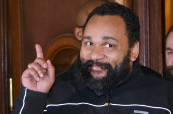 French comedian Dieudonne M'Bala M'Bala gesturing to the media as he leaves a Paris court house, Feb. 4, 2015. (Michel Euler/AP Images)