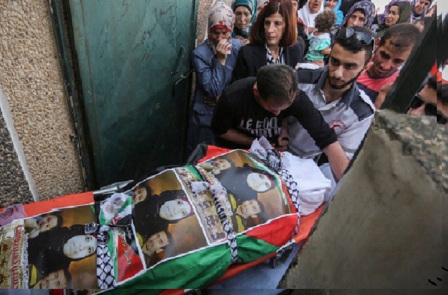 Palestinian mourners carry the body of Riham Dawabsha, whose baby son and husband were killed in the July firebombing of the family's home, during her funeral at the cemetery in the West Bank village of Duma, Sept. 7, 2015. (Flash90)