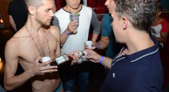 "A ""shot boy"" and guests at the annual ""High Homodays"" party, held this year on Sept. 19, 2015. (Andrew Werner)"
