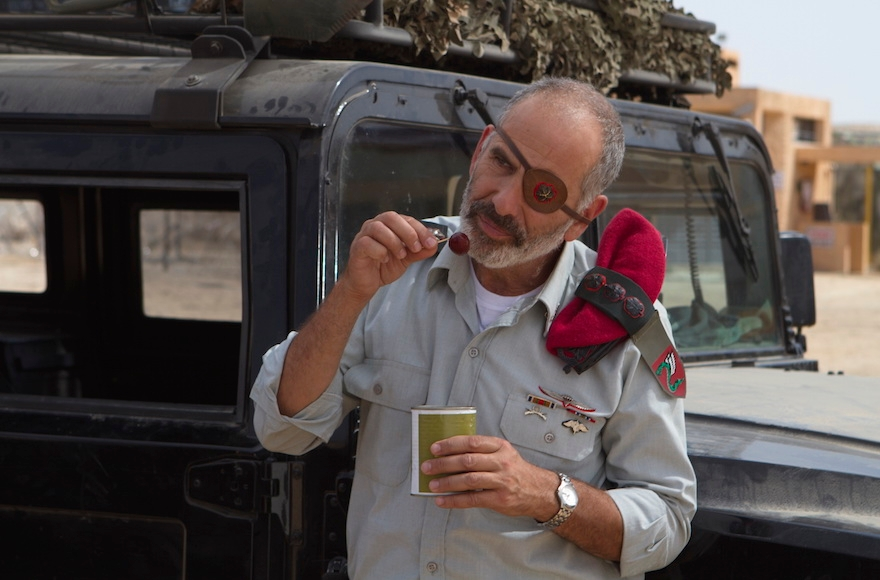 "An Israeli army officer eating falafel in a scene from ""Atomic Falafel."" (Courtesy of Dror Shaul)"