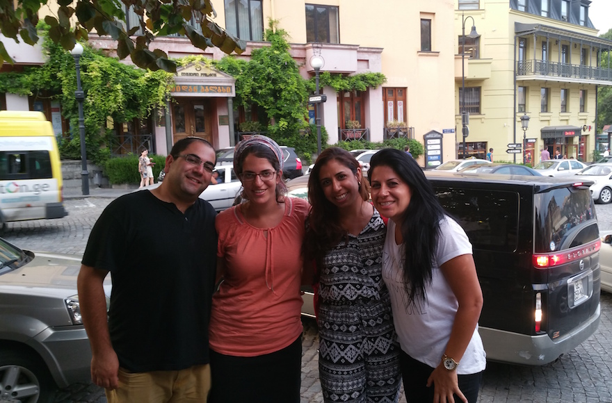 Liad Shemesh, an Israeli tourist, standing outside the Great Synagogue of Tbilisi with his wife, Einat, Adi Amram and Ortal Panehla on Aug. 20, 2015. (Cnaan Lipshiz)
