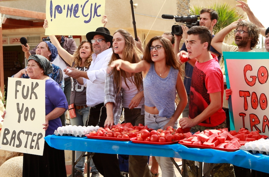 "Israelis protesting a United Nations nuclear inspector in a scene from ""Atomic Falafel."" (Courtesy of Dror Shaul)"