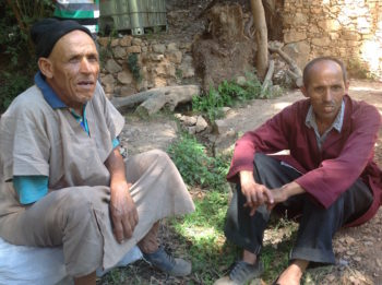 Etrog grower (and retired restaurant worker) Mohammed Douch, left,  with his cousin. (Ben Sales)