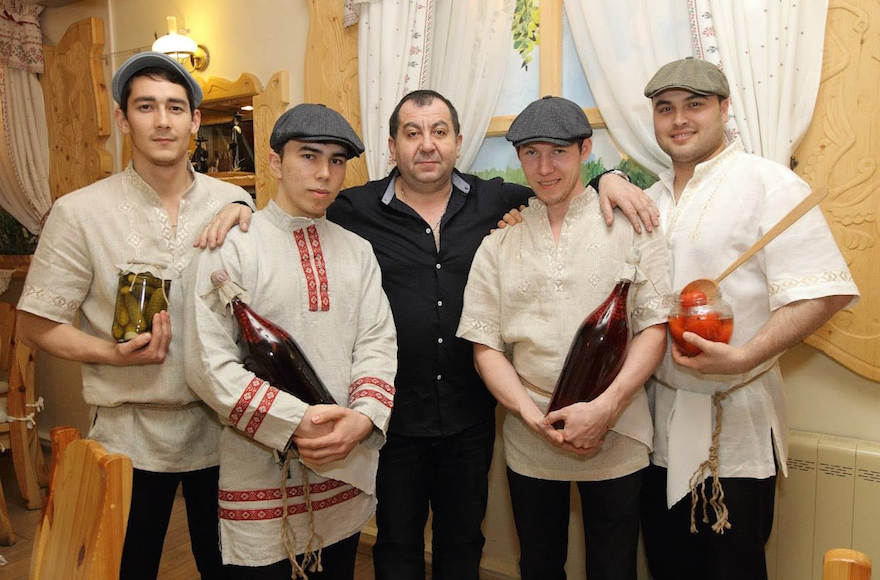 Pinhas Slobodkin, center, with staff at a Moscow event serving kosher food in 2014. (Courtesy of Pinhas Slobodkin)